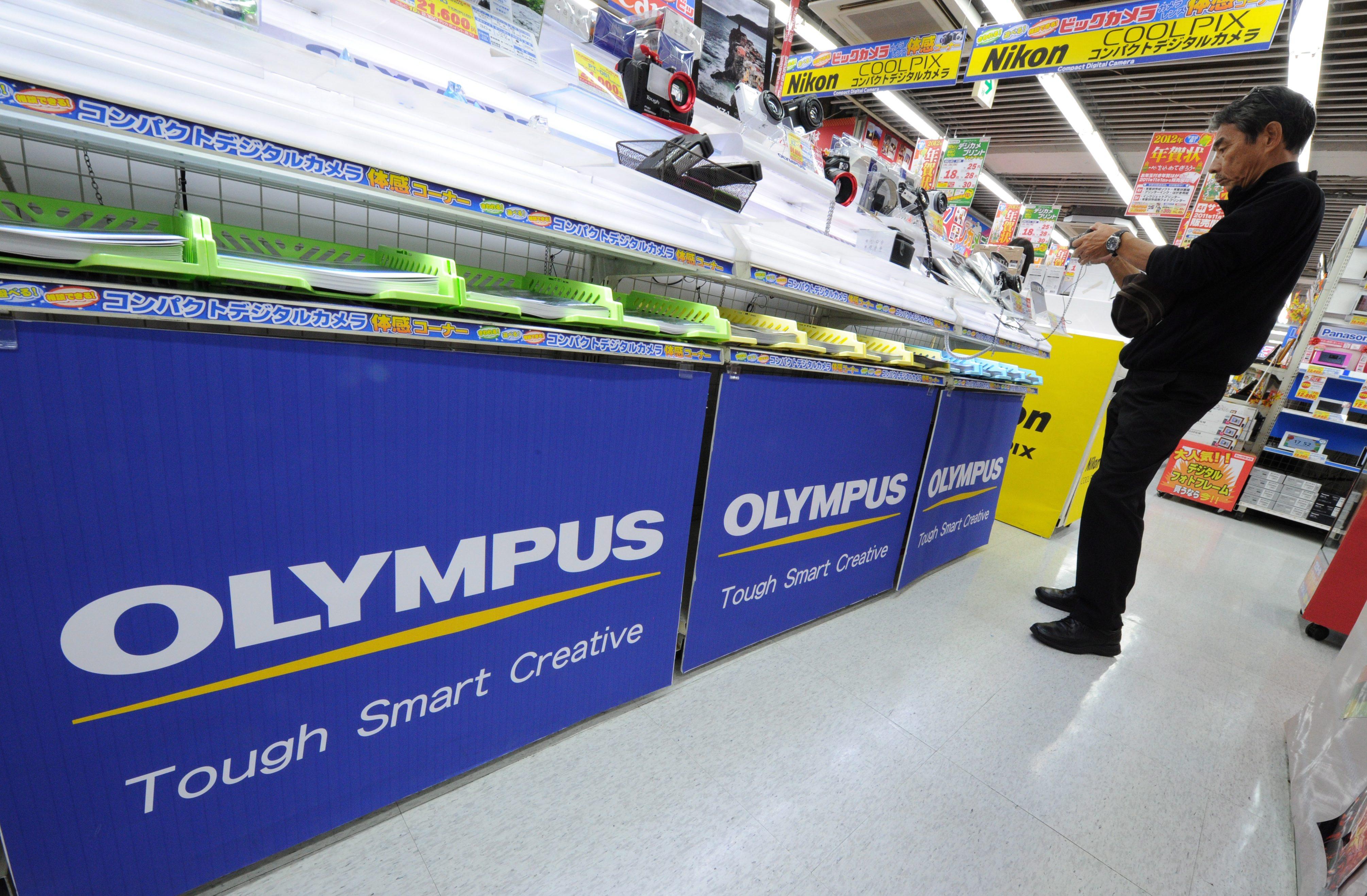 Olympus призна за укриване на загуби