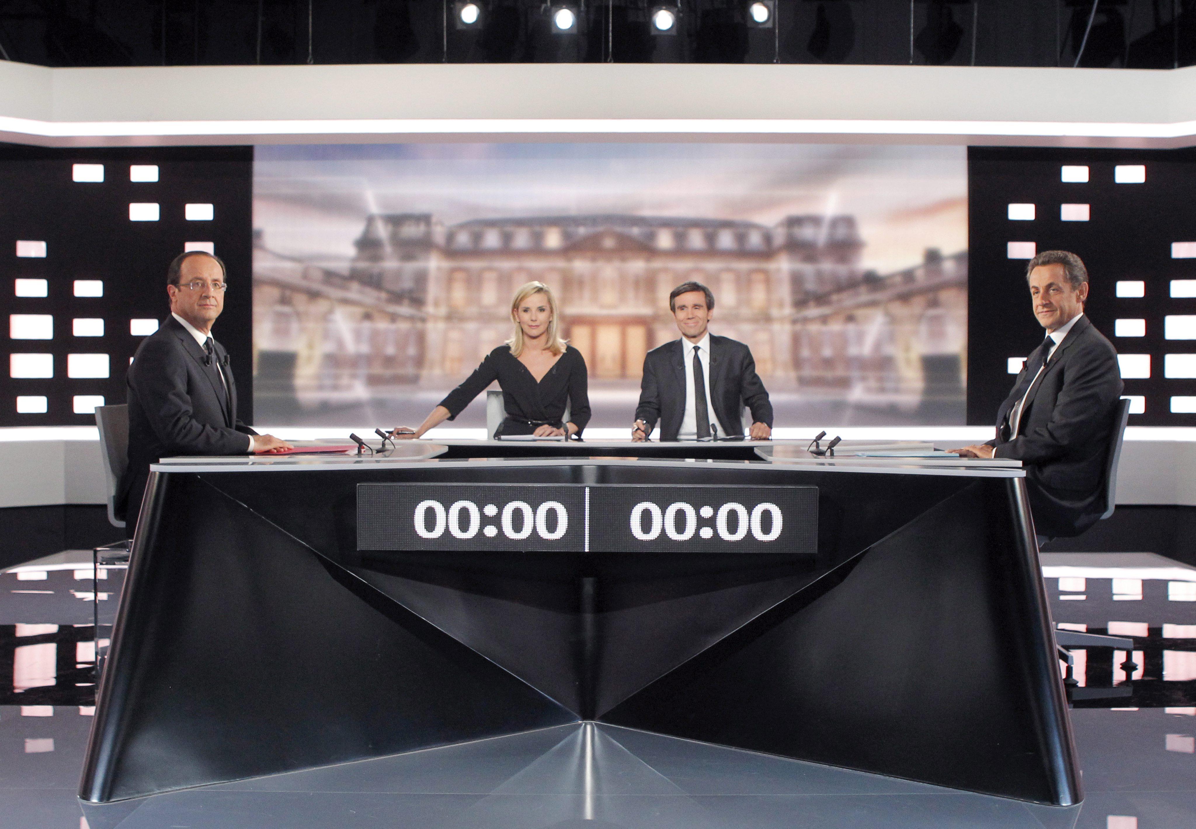 Яростен дебат между Саркози и Оланд