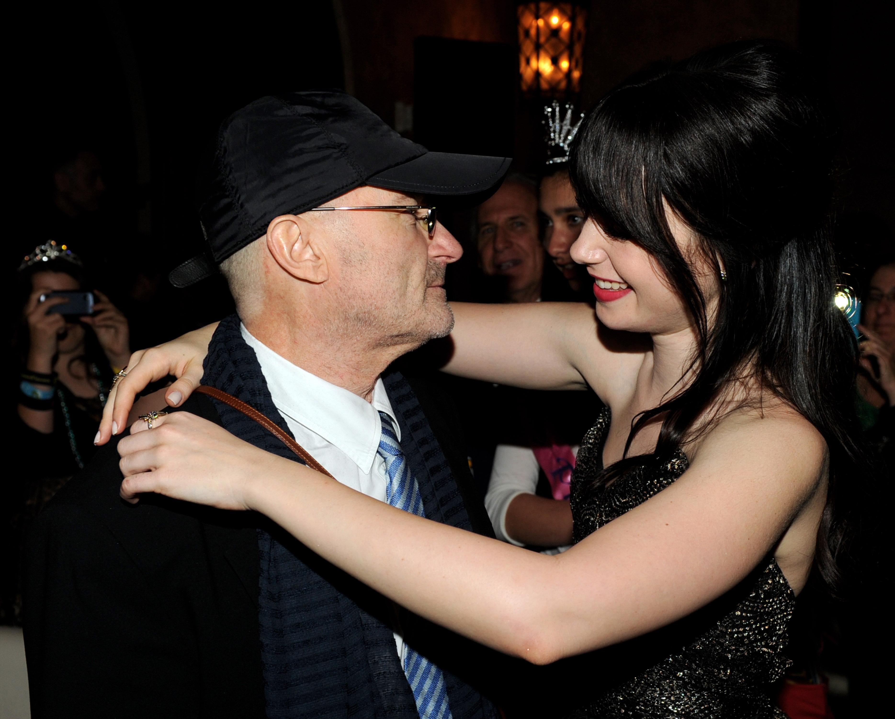 Фил Колинс с дъщеря си Лили