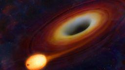 Астрономи откриха различна по размер черна дупка, поглъщаща звезди