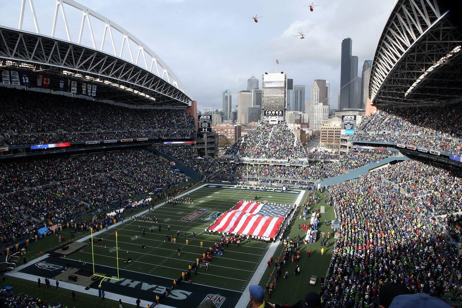 """Сиатъл е красив град и това личи от тази гледка на """"СенчъриЛинк Фийлд"""". Арената е дом на Сиатъл Сийхоукс (американски футбол) и Сиатъл Саундърс (футбол). Събира 67 хиляди души и това със сигурност е най-красивата му снимка."""