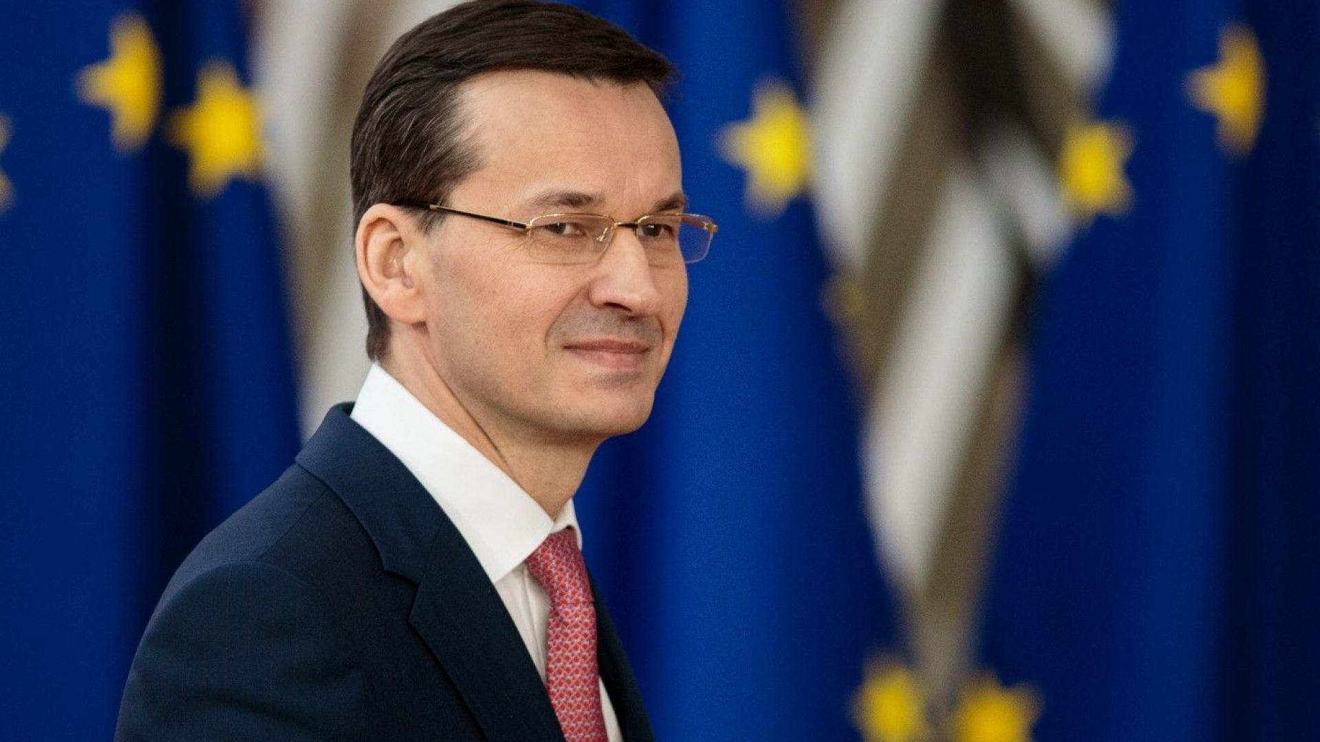 Премиерът на Полша Матеуш Моравецки заедно с жена си се