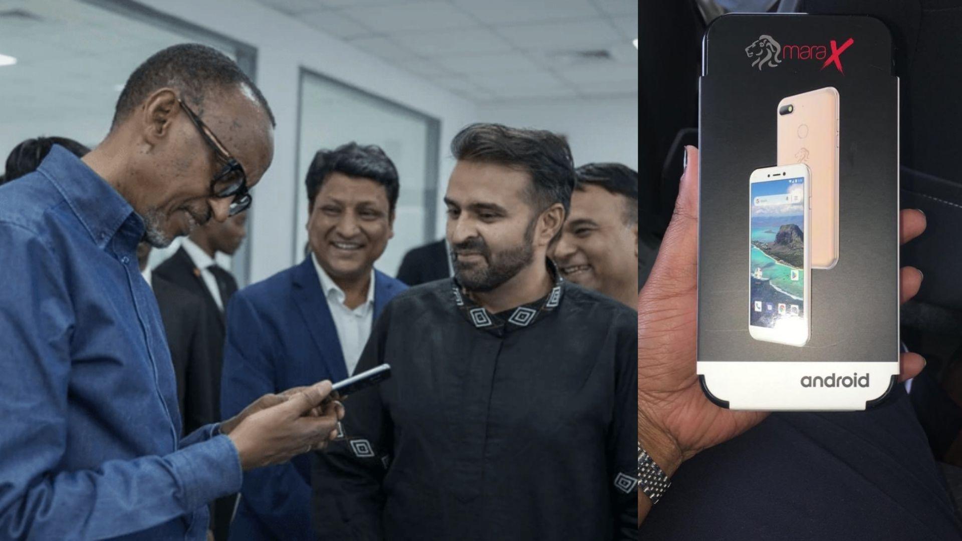 Президентът на Руанда Пол Кагаме разглежда телефонът