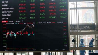 Азиатските фондови борси отбелязаха рязък спад след срива на Уолстрийт