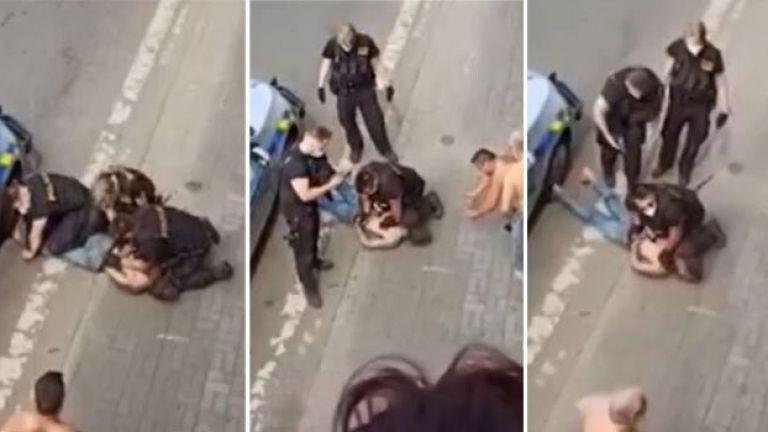 Видеозаписи на полицай, свалил на земята мъж от ромски произход